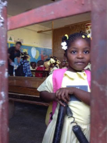 Nursery school girl hopes for a bright, healthy future.