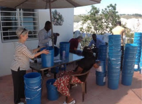 Elena and her Haiti team prepare for distribution of filters and buckets.
