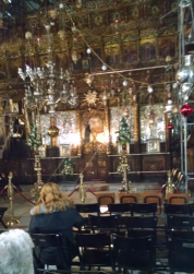 Pilgrims waiting in silent meditation in the Greek Orthodox chapel.